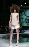 Fashion model wearing clothes designed by Marina Design on the 'Fashion.hr' show in Zagreb, Croatia — Stock Photo