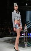 Fashion model wearing clothes designed by Zoran Aragovic on the 'Fashion.hr' show in Zagreb, Croatia. — Stock Photo
