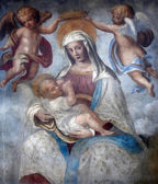 Blessed Virgin Mary with baby Jesus, street wall painting, Parma, Italy — Stock Photo
