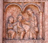 Christ Performing Works of Mercy relief at the baptistry, Parma, Italy — Stock Photo