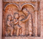 Christ Performing Works of Mercy relief at the baptistry, Parma, Italy — Foto de Stock