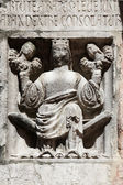 Faith (holding Justice and Peace) relief at the baptistry from Parma, Italy — Stock Photo