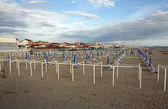 Typical Italian beach chairs in Viareggio, one of the most well known summer italian vacation spots — Stock Photo
