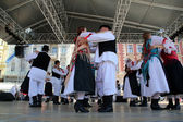 Members of folk groups Veseli Medimurci from Croatia during the 48th International Folklore Festival in center of Zagreb,Croatia on July 16, 2014 — Stock Photo