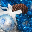 Christmas ball on the tinsel background — Stock Photo