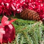 Christmas ball (heart) on fir branch background — Stock Photo
