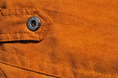 Abstract chamois background with seam and fastener — Stock Photo