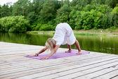 Woman practising yoga exercise — Stock Photo