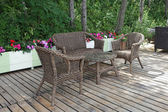 Rattan patio chairs and table — Stock Photo