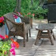 Rattan patio chair and table — Stock Photo
