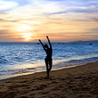 Silhouette dancing  woman on the sunset — Stock Photo