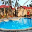 Tropical resort with swimming pool — Stock Photo #18840289