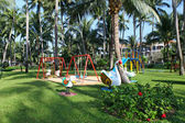 Children's playground at tropical park — Foto Stock