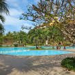 Tropical resort with swimming pool — Stock Photo #19385117
