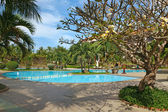 Tropical resort with swimming pool — Stock Photo