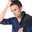 Portrait of thinking young man — Stock Photo