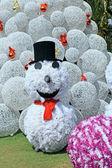 Snowman on christmas tree background — Foto de Stock