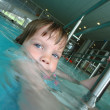 Stock Photo: Child in swiing pool