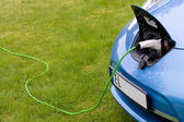 Charging electric car — Stockfoto