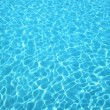 Clear blue water in swimming pool — Stock Photo