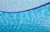 Blue clear water in swimming pool — Stock Photo