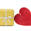 Golden gift box and red heart shaped card — Stock Photo