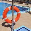 Lifebuoy at swimming pool — Stock Photo