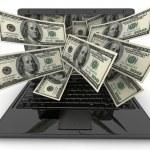 Black laptop and money — Stock Photo #13240237