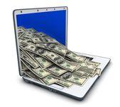 Laptop and many money — Stock Photo