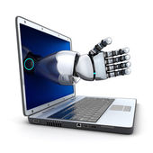 Laptop and the robot arm — Stockfoto