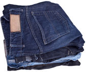 Stack of Various Shades of Blue Jeans, completely isolated on wh — Stock Photo