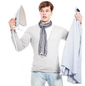 Young man overwhelmed with electric iron and shirt - isolated on — Stok fotoğraf
