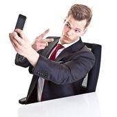 Handsome young businessman taking a selfie with his smartphon — Stock Photo