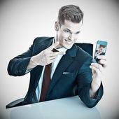 Businessman taking a selfi — Stock Photo