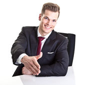 Friendly businessman giving hand for a handshake to seal the agr — Stock Photo
