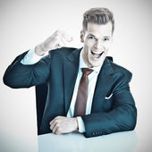 Young businessman enjoying the succes — Stock Photo