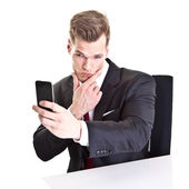 Young businessman taking a selfie with his smartphone - isolated — Stock Photo