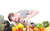 Crazy athletic man with fruits and vegetables, isolated on white — Stock Photo