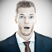 Businessman with astonished expressio — Stock Photo