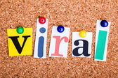 The word viral in cut out magazine letters pinned to a cork noti — Stock Photo
