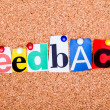 The word Feedback in cut out magazine letters pinned to a cork n — Stock Photo