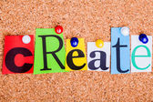 The word Create in cut out magazine letters pinned to a cork not — Stock Photo