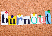 The word Burnout in cut out magazine letters pinned to a cork no — Stock Photo