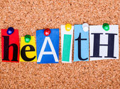 The word Health in cut out magazine letters pinned to a cork not — Stock Photo