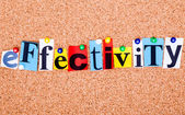 The word effectivity in cut out magazine letters pinned to a cor — Stock Photo