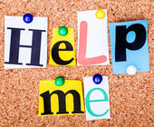 The phrase Help me in cut out magazine letters pinned to a cork  — Stock Photo