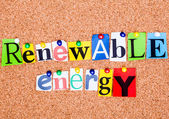 The phrase Renewable energy in cut out magazine letters pinned t — Stock Photo