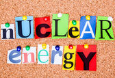 The phrase nuclear energy in cut out magazine letters pinned to  — Stock Photo
