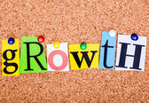 The word growth in cut out magazine letters pinned to a cork not — Stock Photo