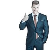 Young professional businessman showing thumb u — Stock Photo